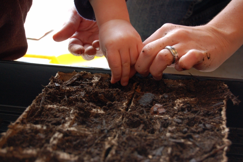 mom & toddler planting seeds