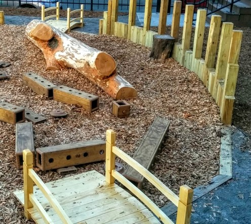 10-foot long, smoothed tree trunk and wood blocks for kinetic play