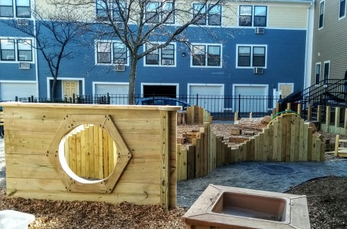 custom-built wood play wall and sensory play area